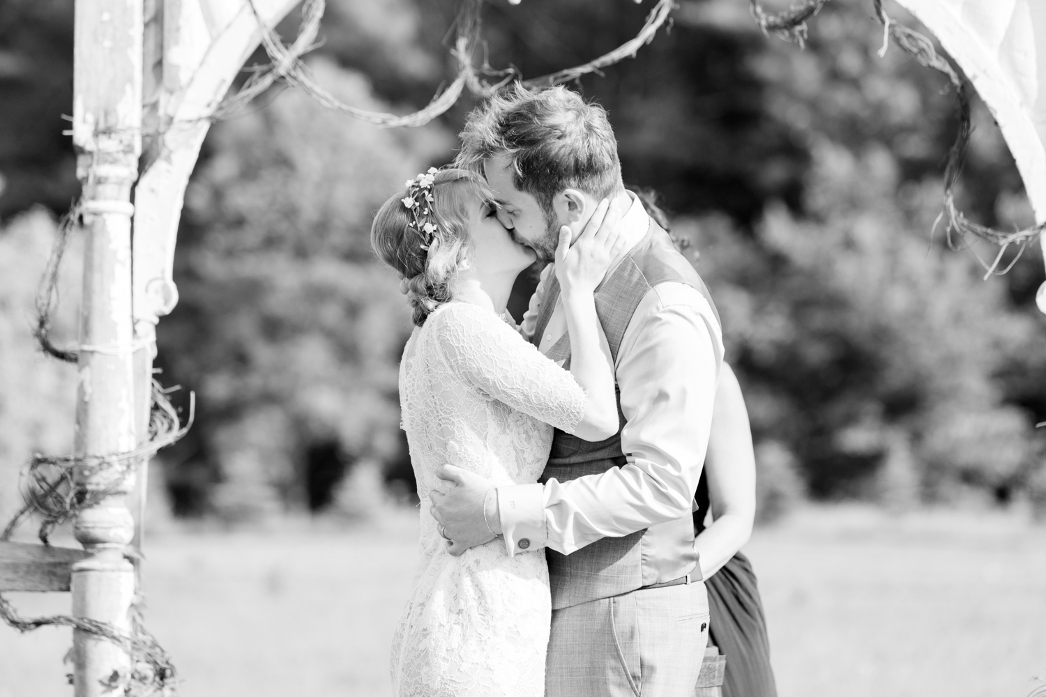 bride and groom share a first kiss