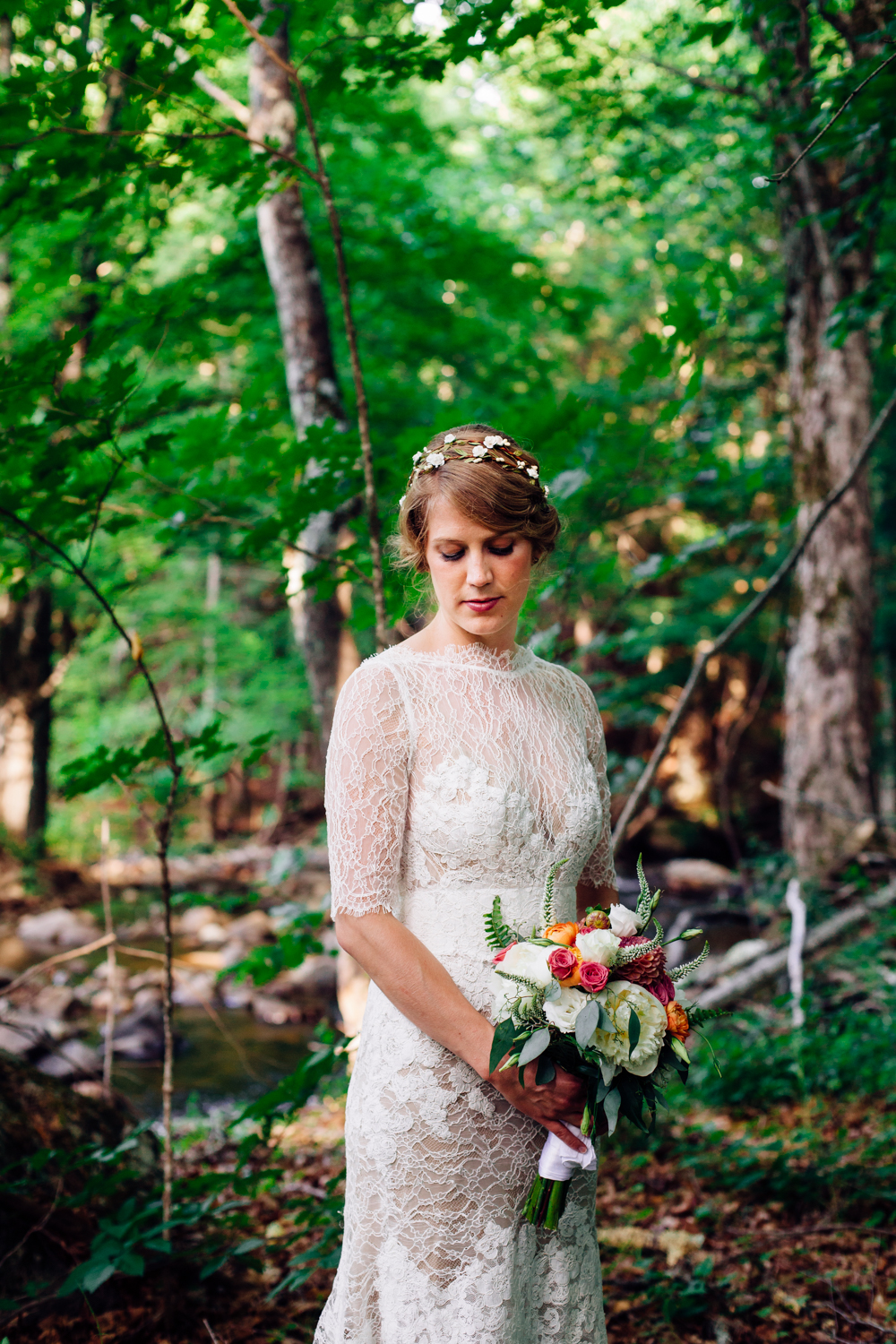A bride poses with her bouquet in upstate New York