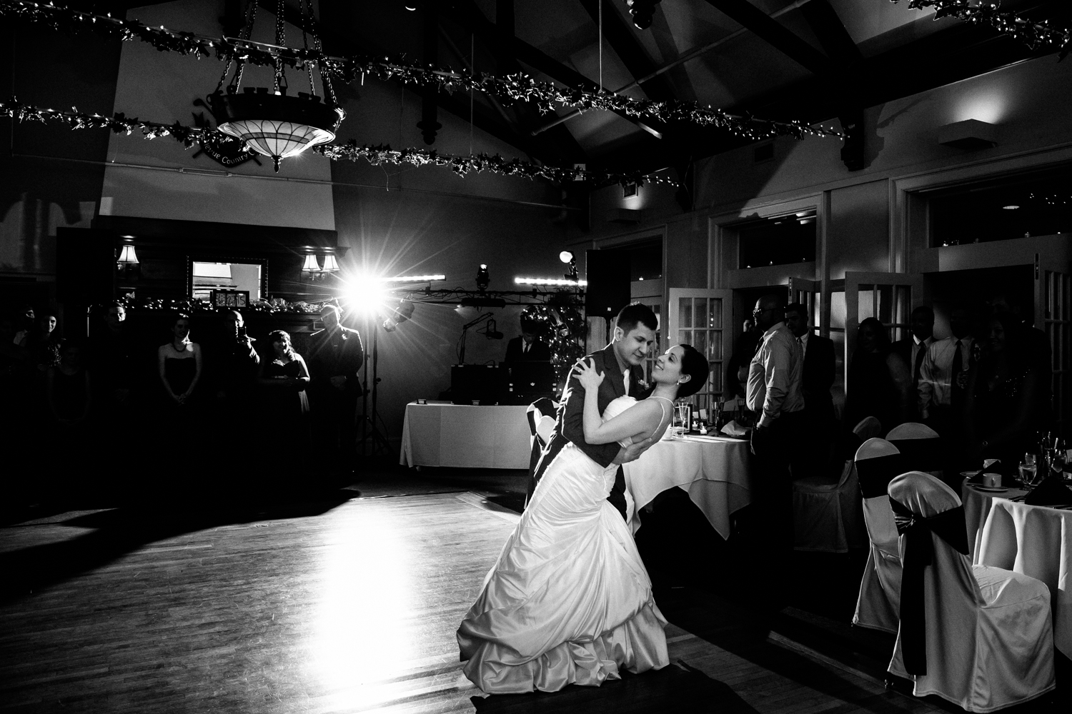 Groom dips bride at the end of the first dance