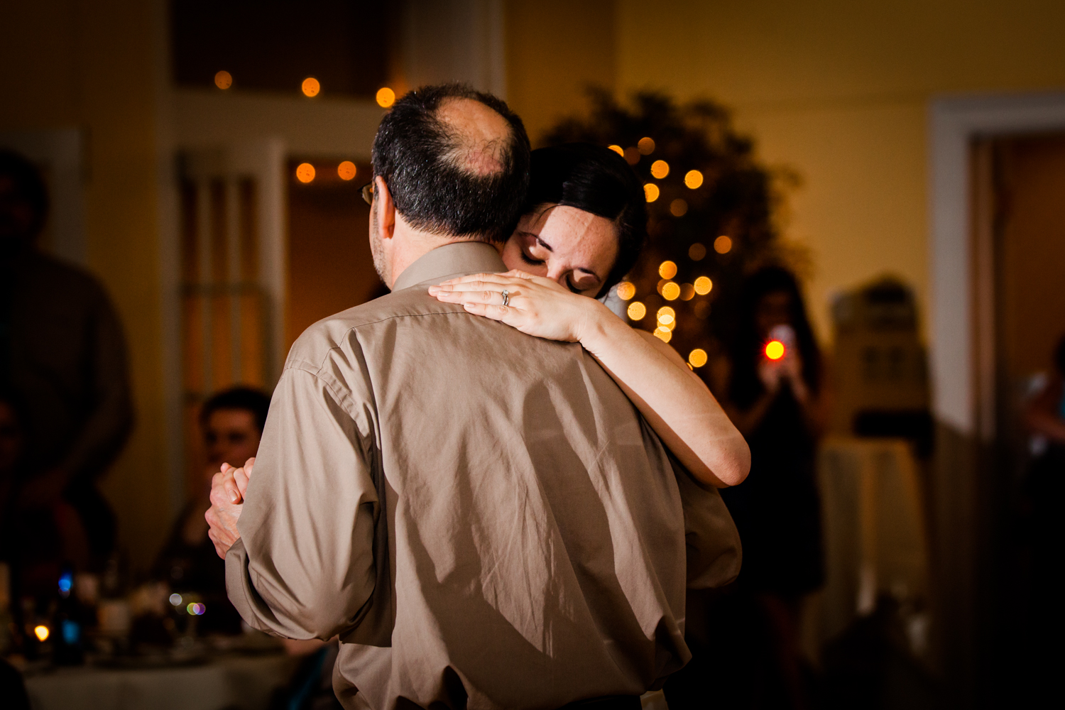 Father and daughter hug during their dance