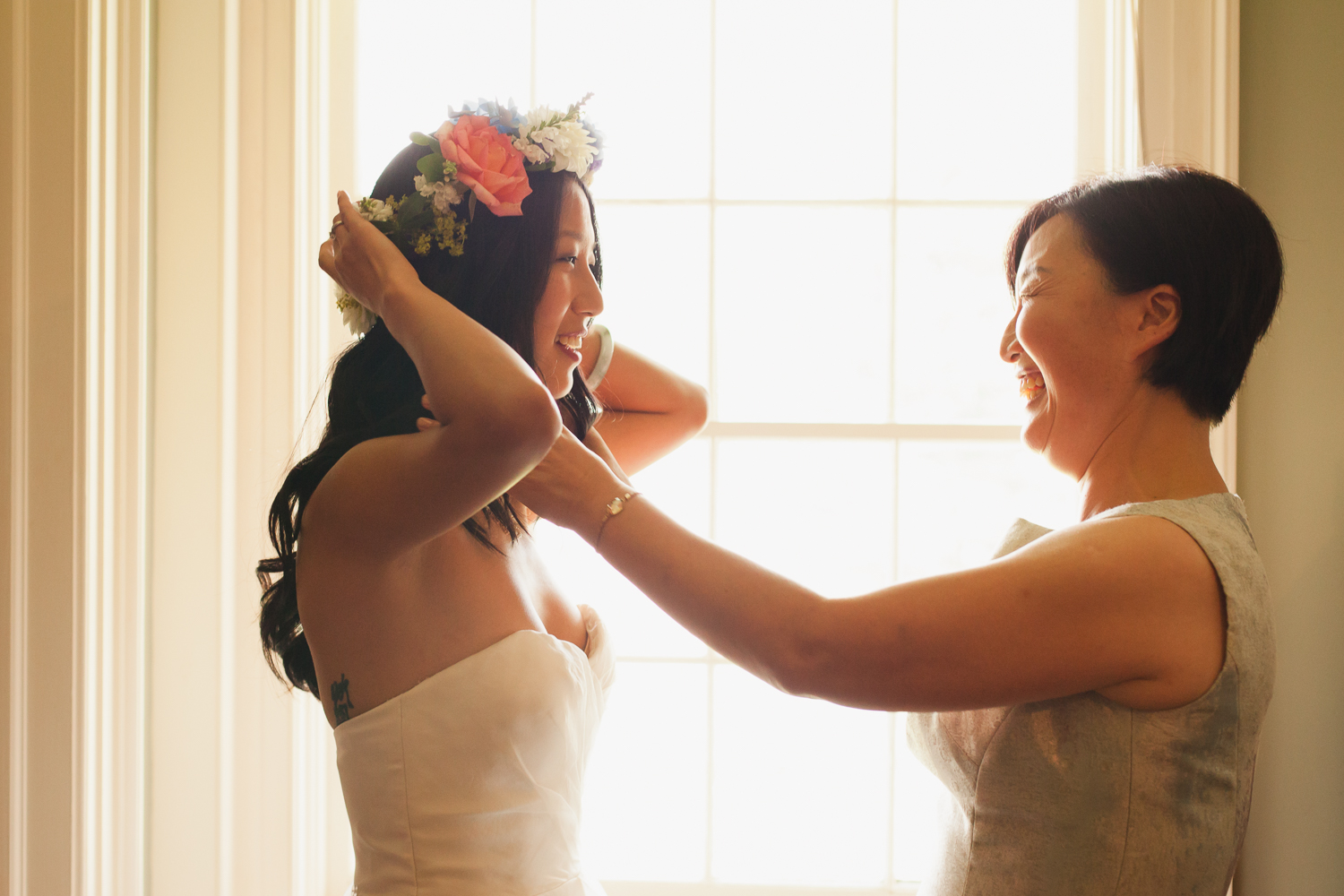 bride and mother share a moment at thefontainebleau inn.