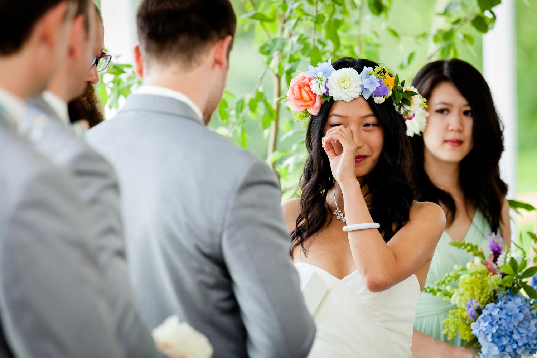bride sheds tear during ceremony