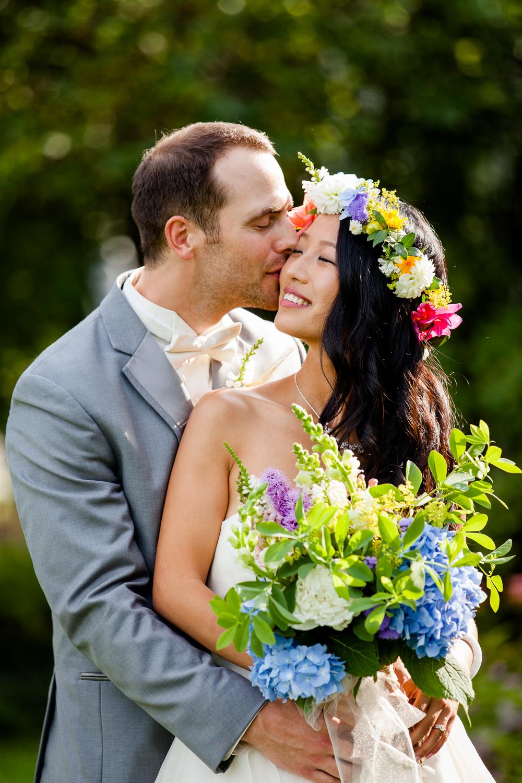 Tender moment between bride and groom