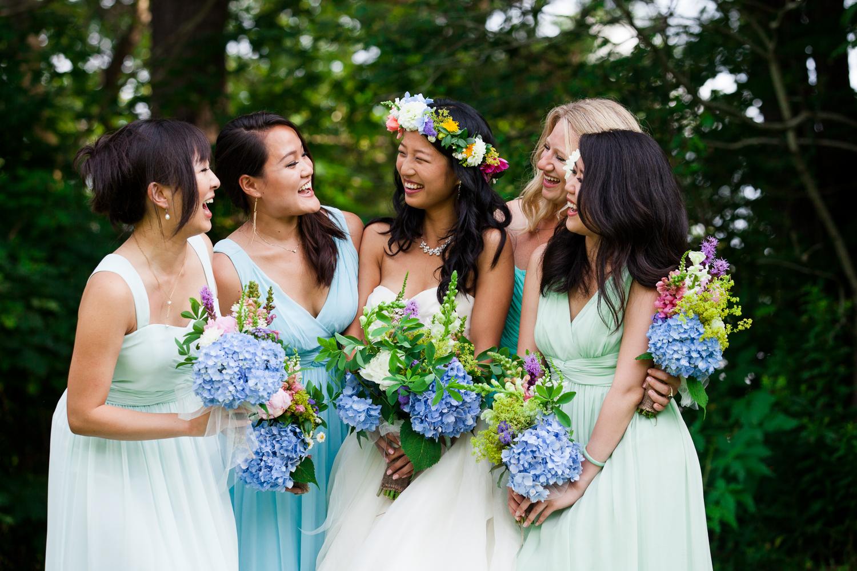bridesmaids laugh together