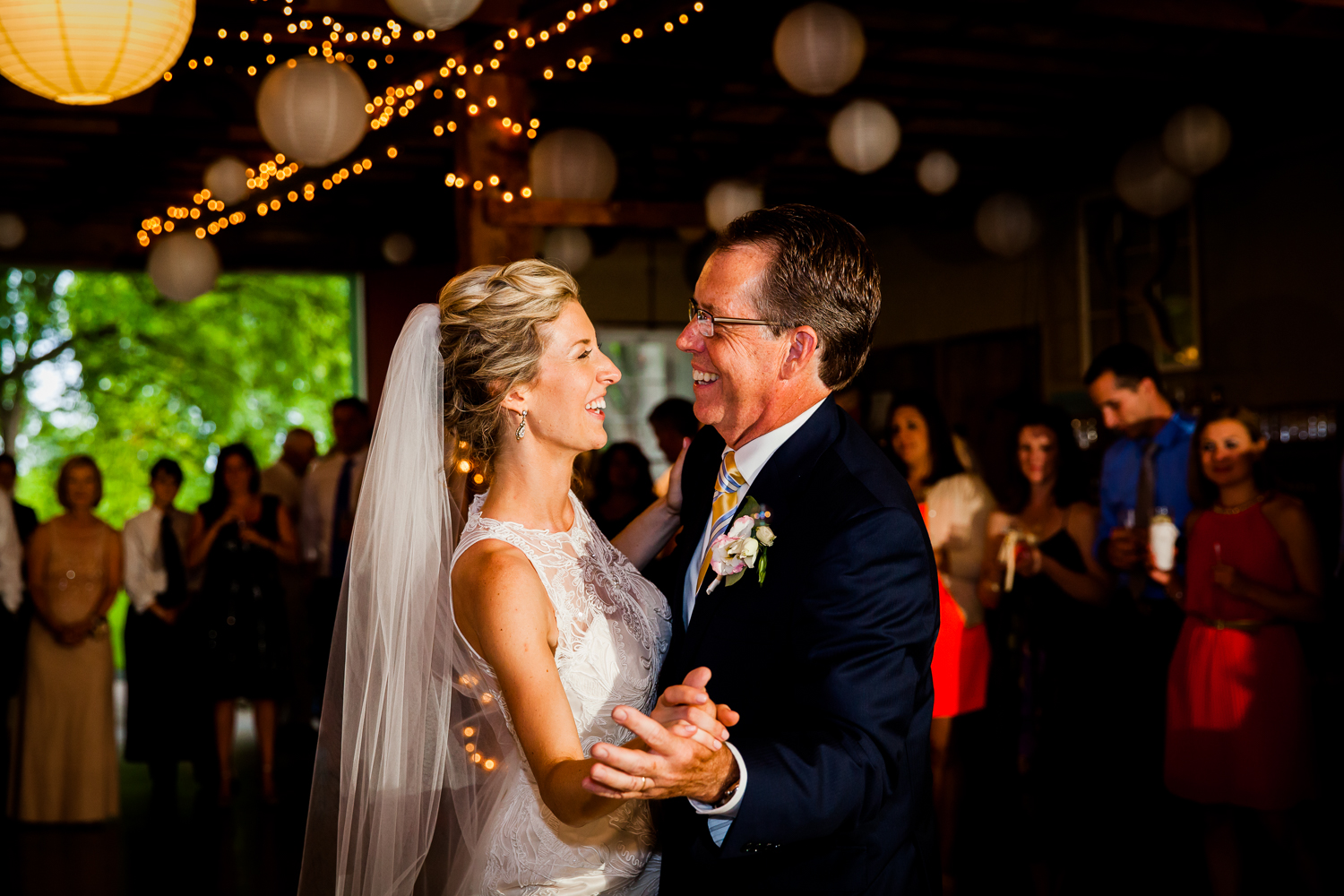 Father and bride share a dance at a barn wedding.