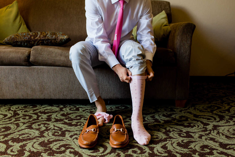 Groom puts on his socks.