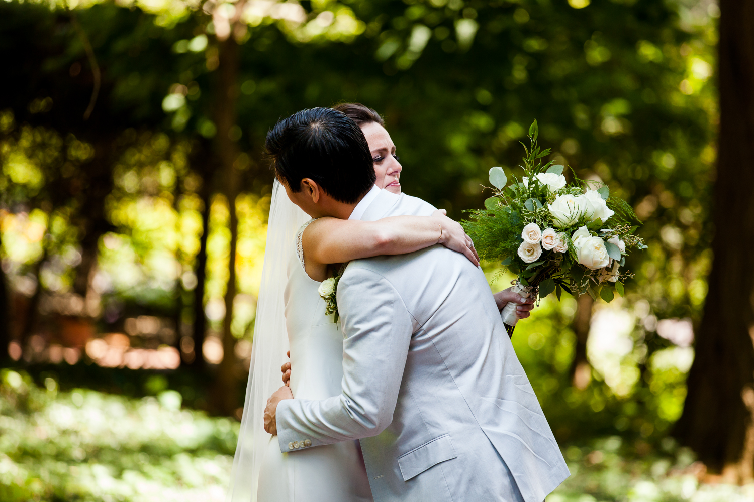 Bride and groom share a touching hug.