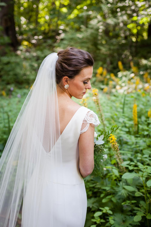 Bride looks over her shoulder.
