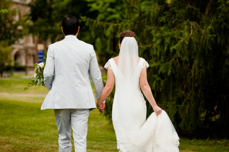 Bride and groom walk away.