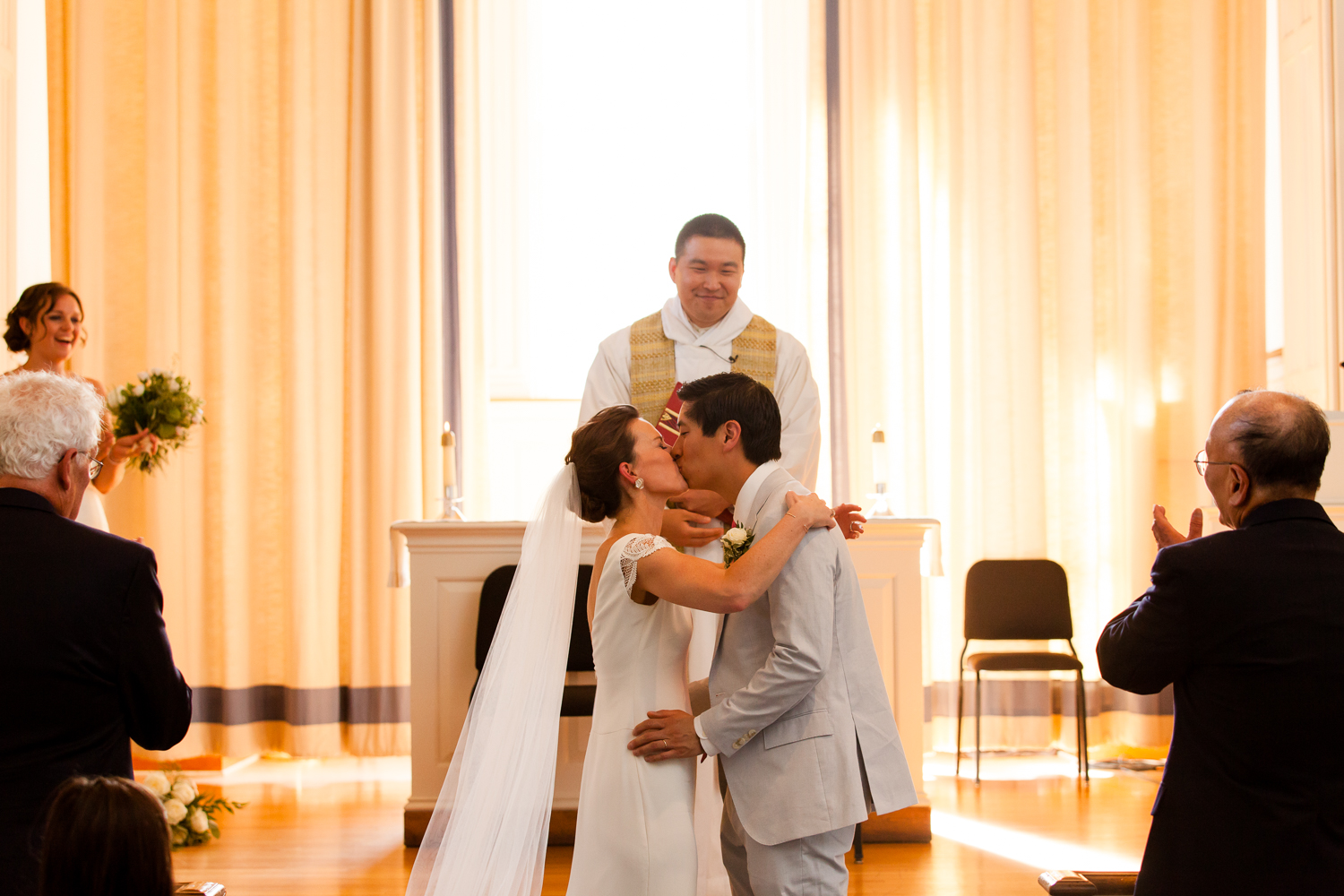 Bride and groom share their first kiss.