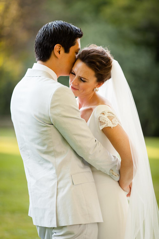 Bride and groom hug.