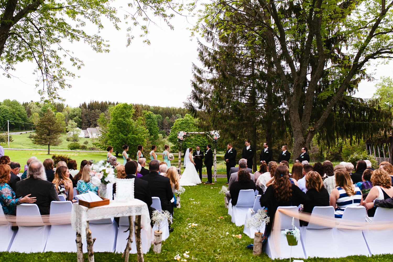 Wide view of an outdoor wedding ceremony.