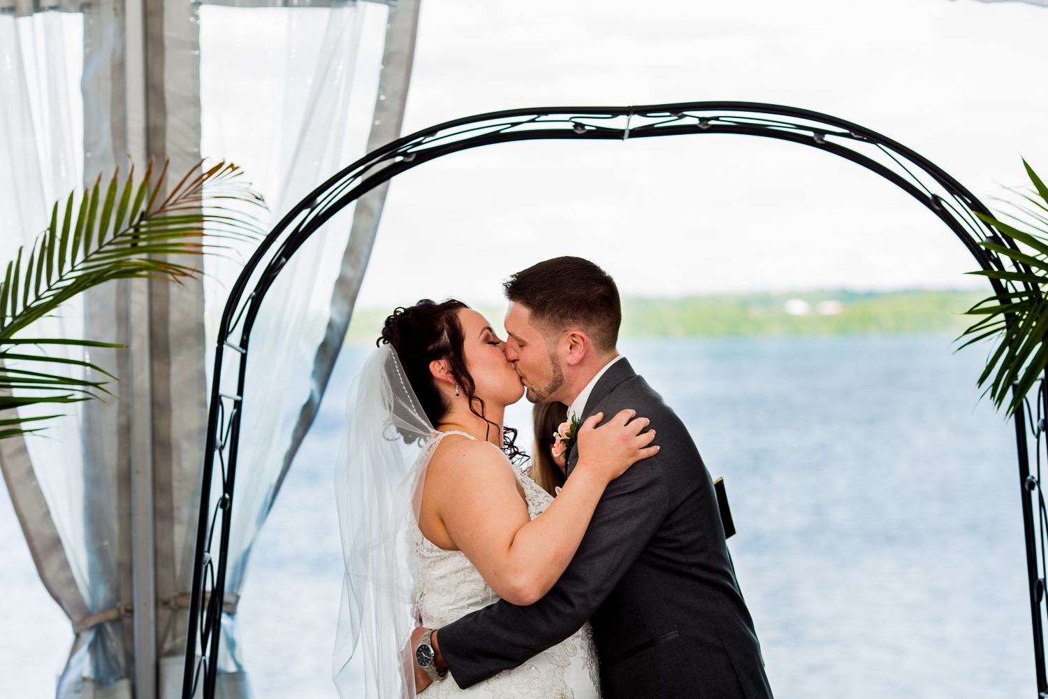 Bride and groom share first kiss.