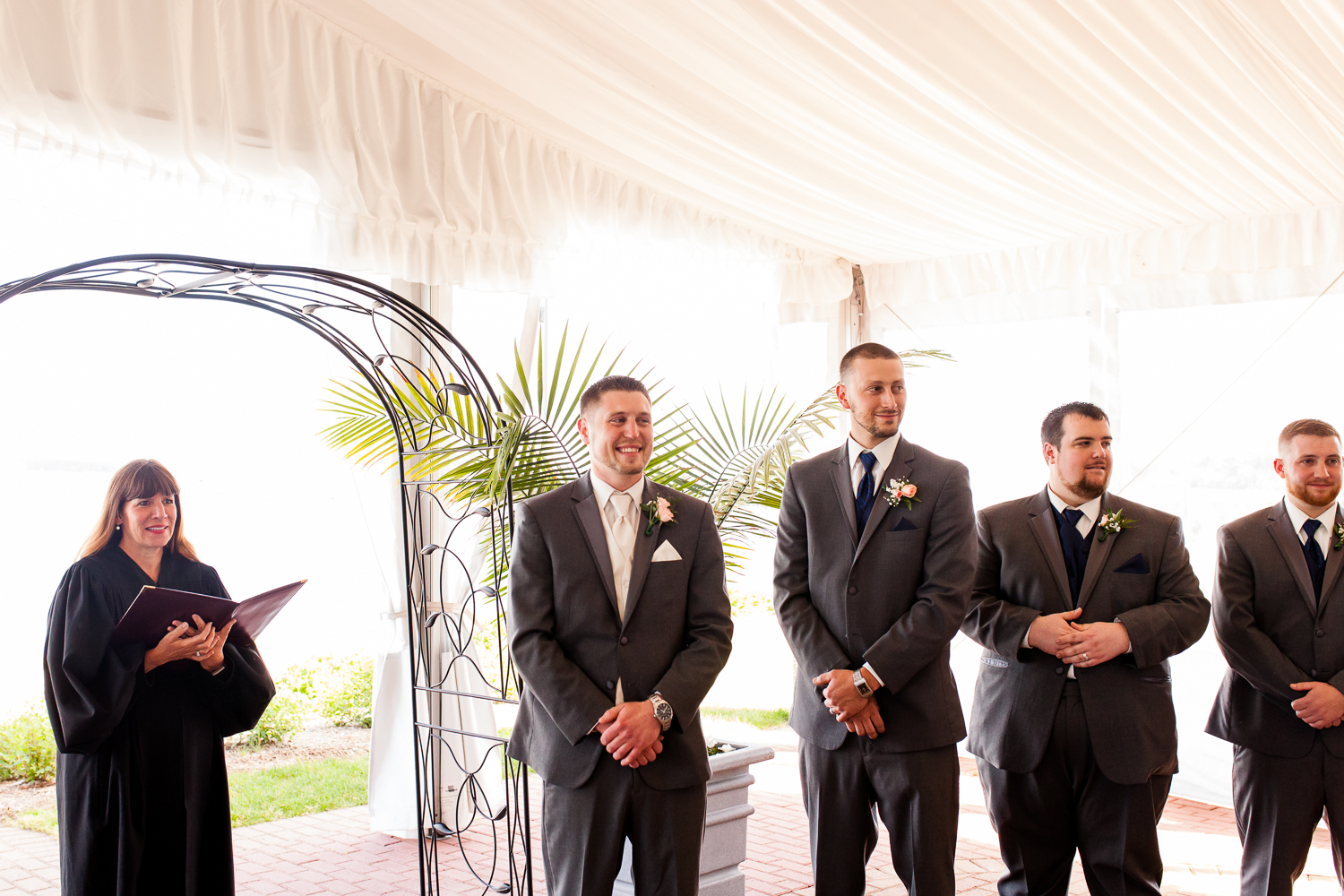 Groom gets emotional seeing his bride walk down the aisle.