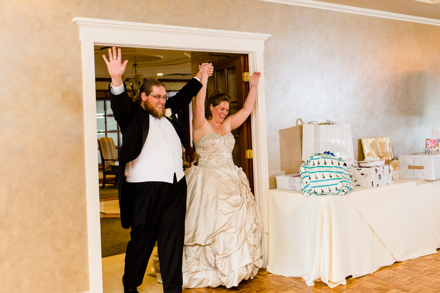 Bride and groom enter their reception hall for the first time as husband and wife. They are at Lakeshore Yacht and Country Club in Cicero, NY.