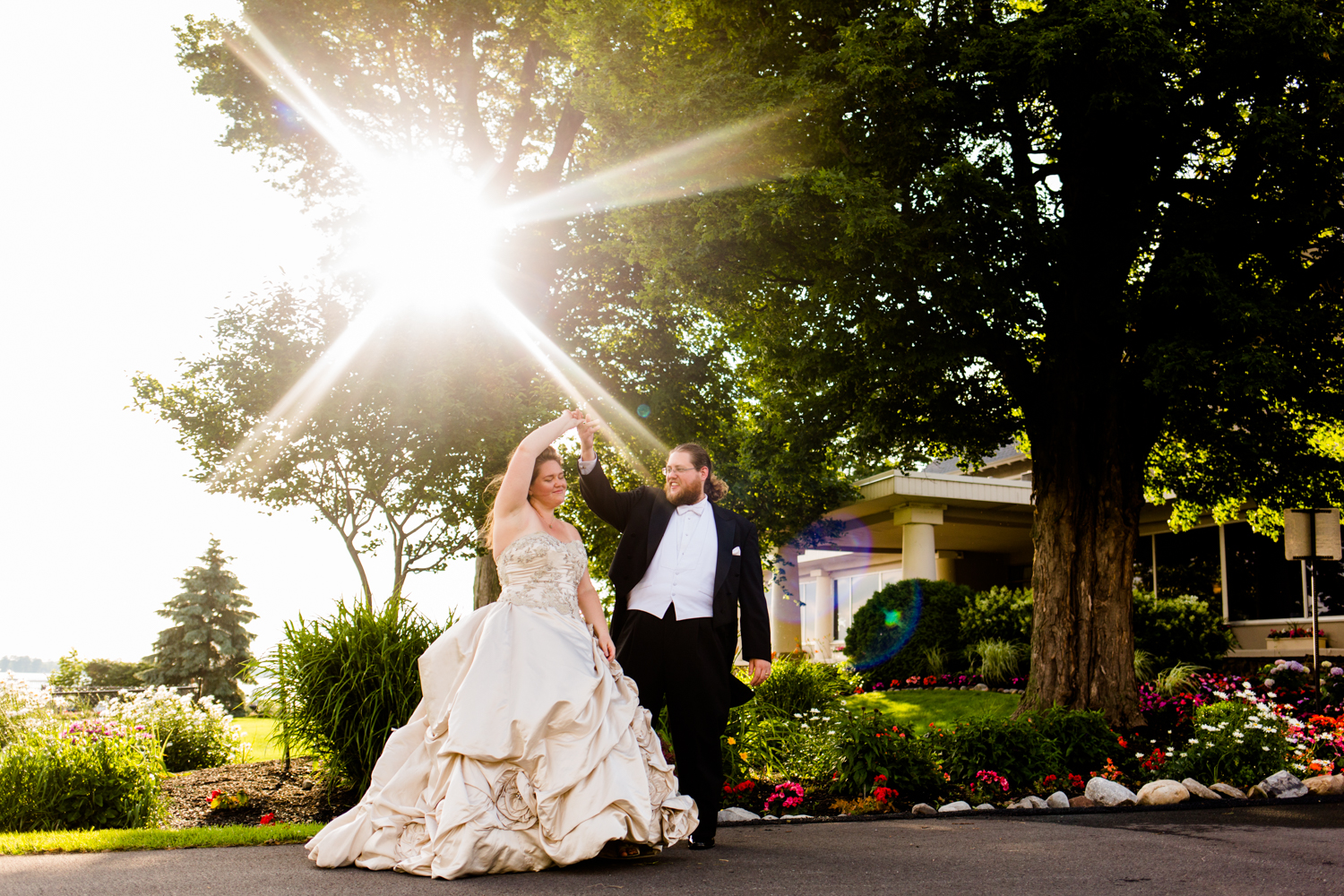 Groom twirls bride at Lakeshore Yacht and Country Club.