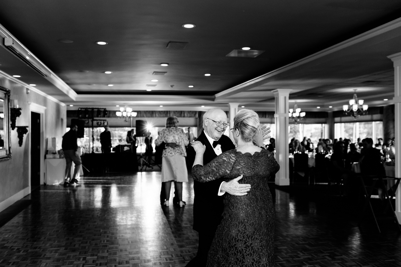 The brides parents dance at the wedding reception.
