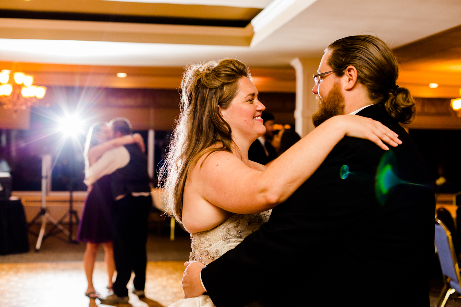 Happy bride and groom dancing image.