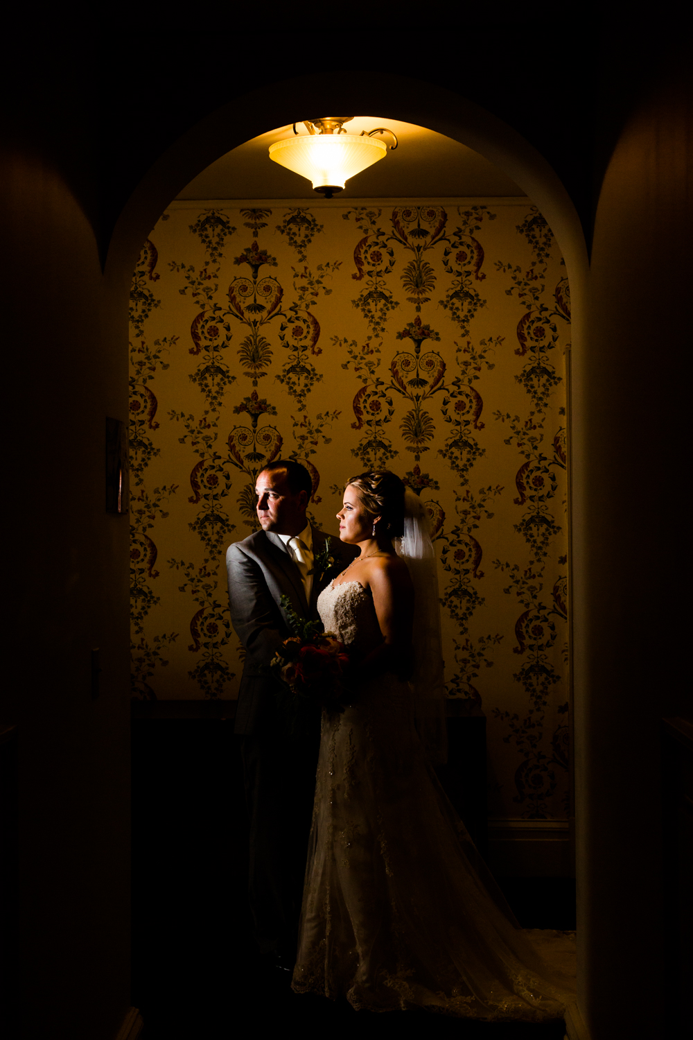 Moody portrait of bride and groom at the Lincklaen House in Cazenovia, NY.