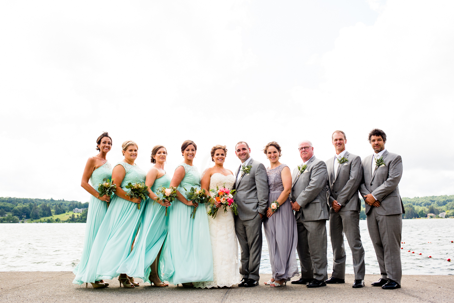 Bridal party in front of a lake.
