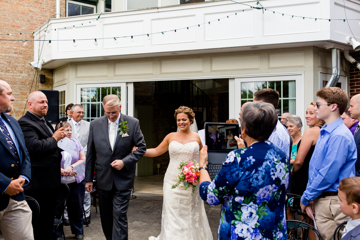 Bride is emotional as she walks down the aisle with her father.