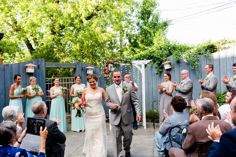 Bride and groom exit the wedding ceremony.
