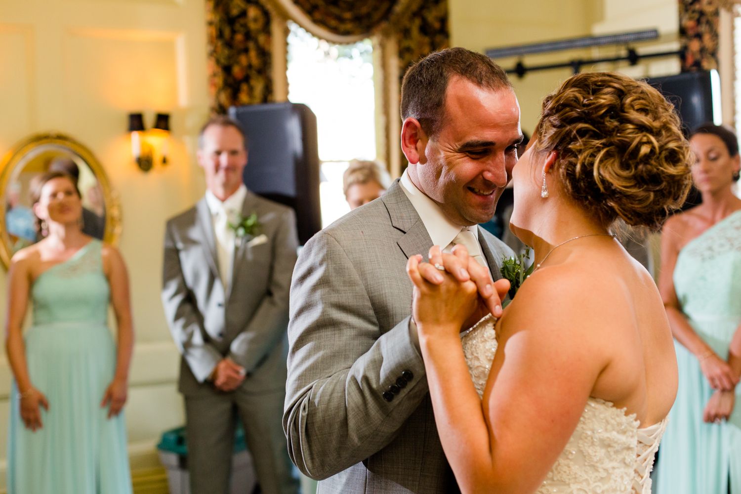 Groom smiles during first dance.