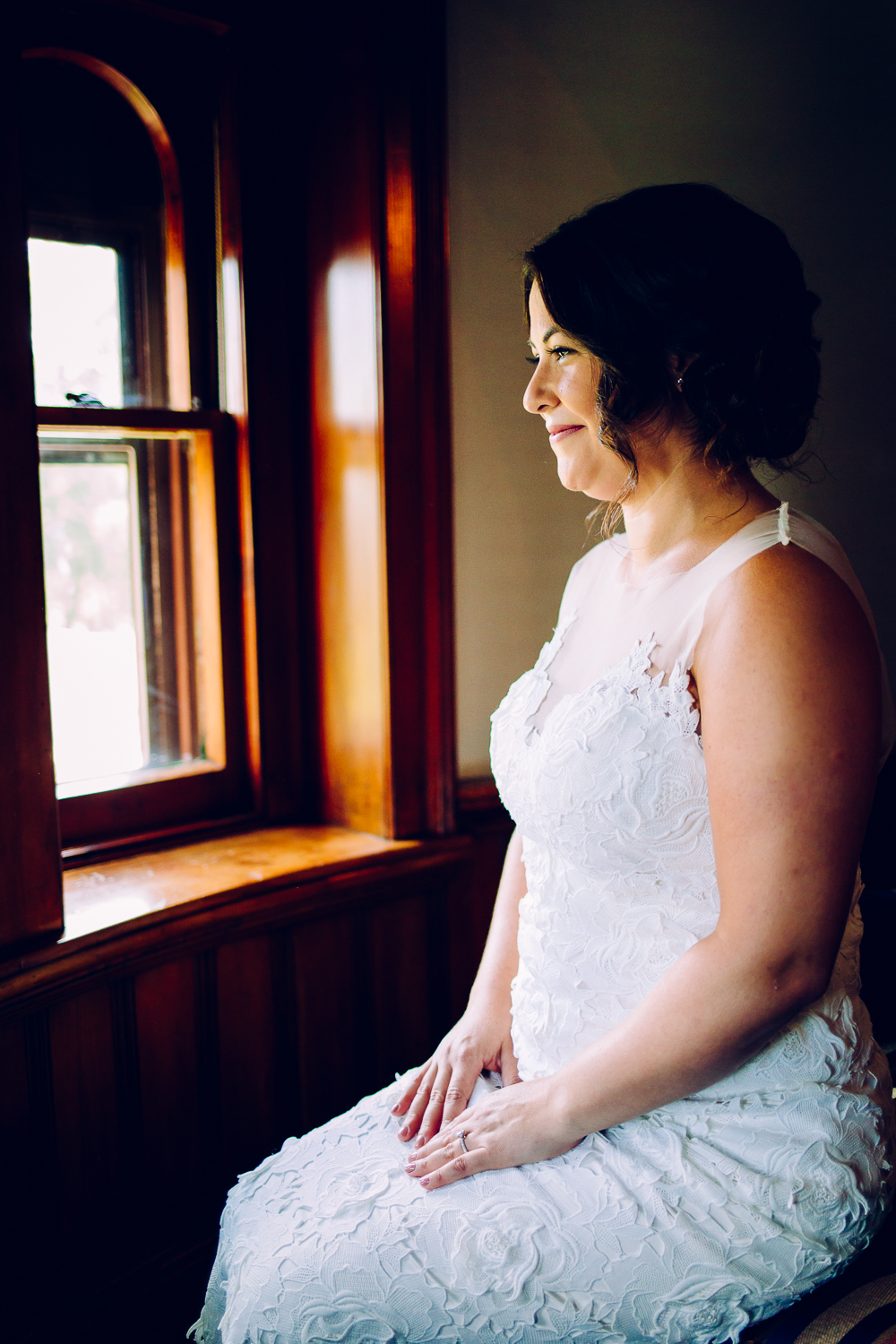 Portrait of bride looking out the window in the Belhurst Castle Tower.