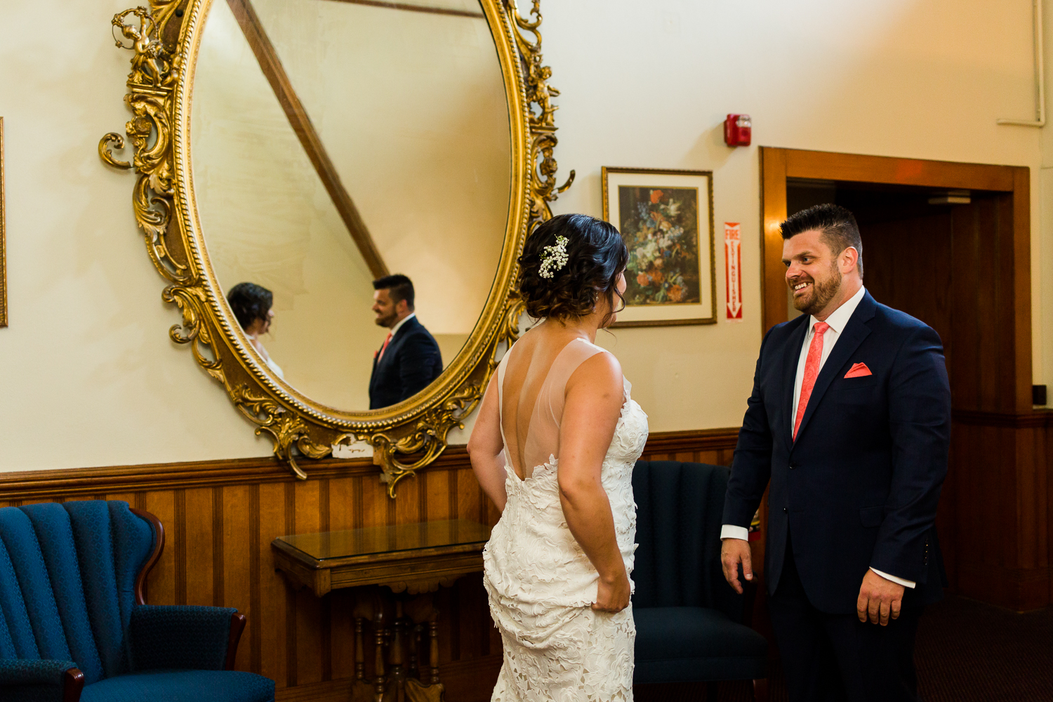 First look between a bride and groom at Belhurst Castle in Geneva, NY.