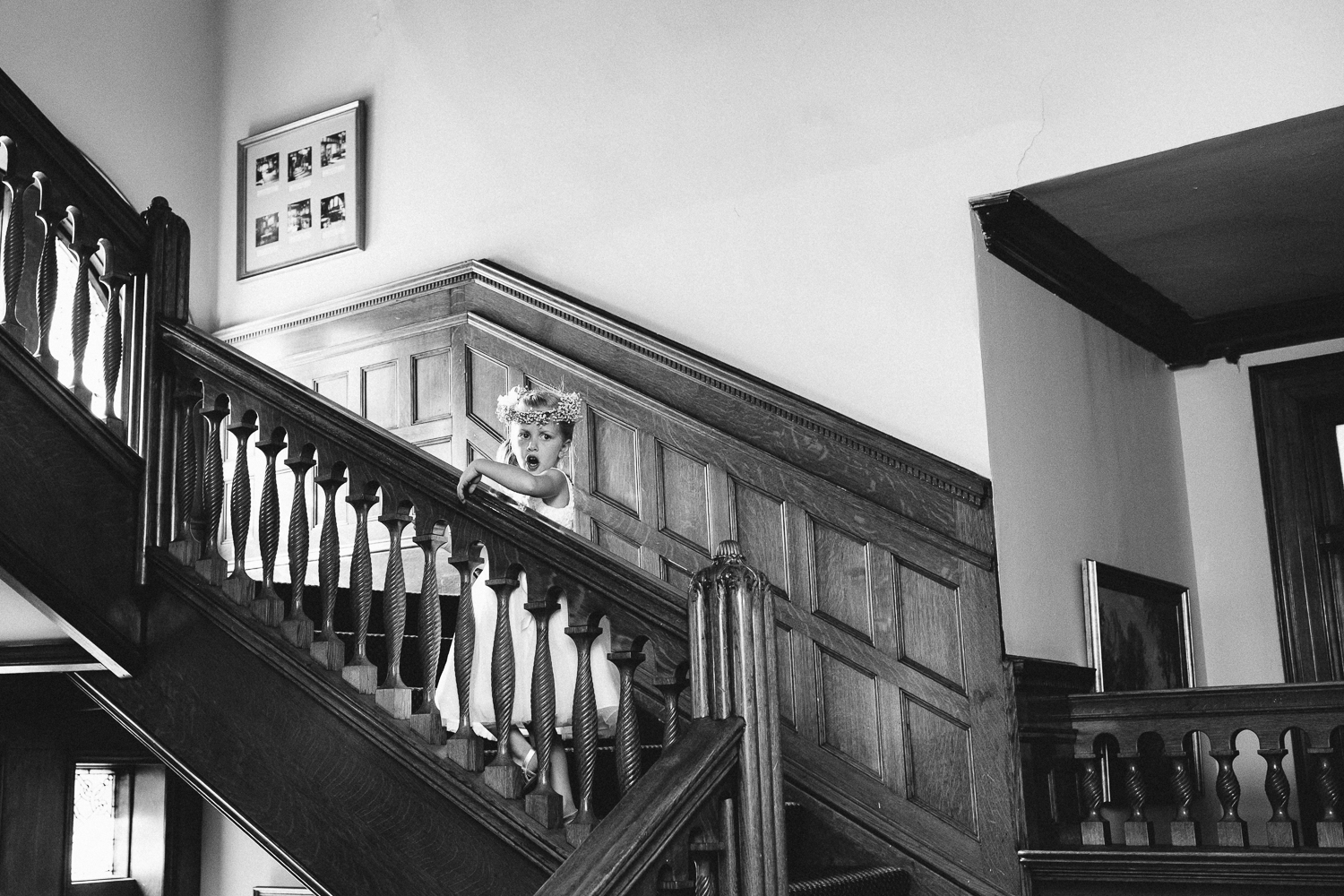 Black and white image of flower girl yelling on the stairs
