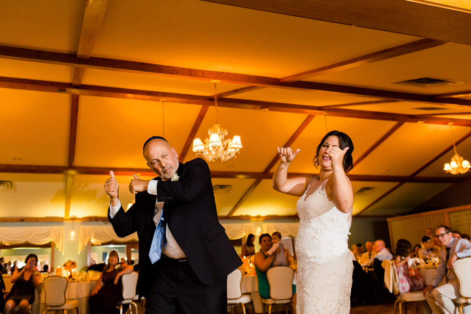Bride does a funny dance with her father.