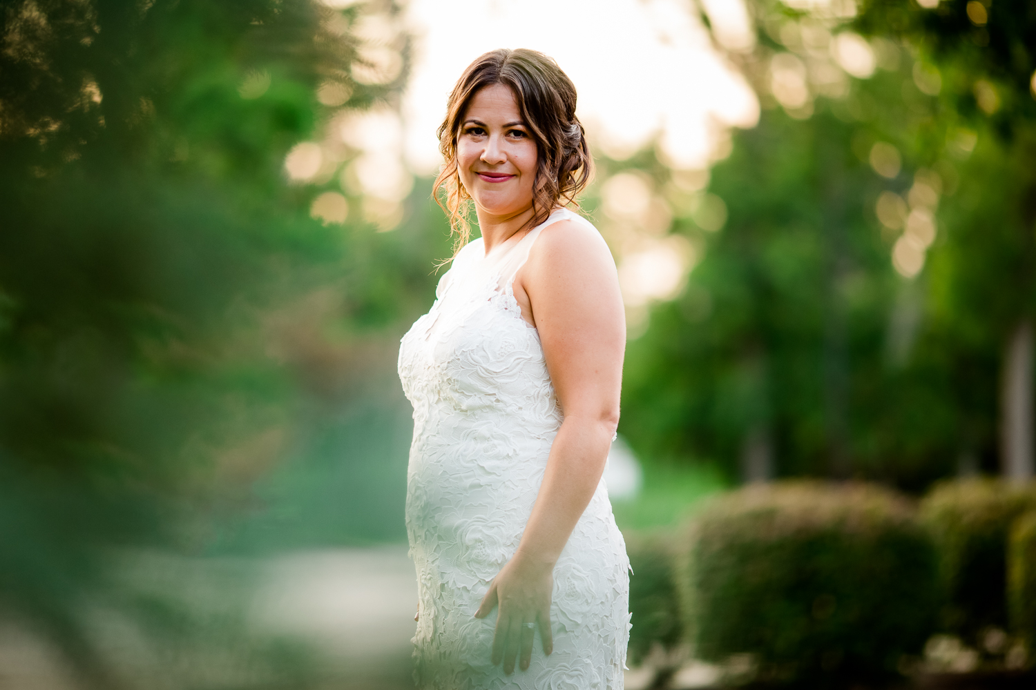 Bridal portrait. Bride is surrounded by trees.