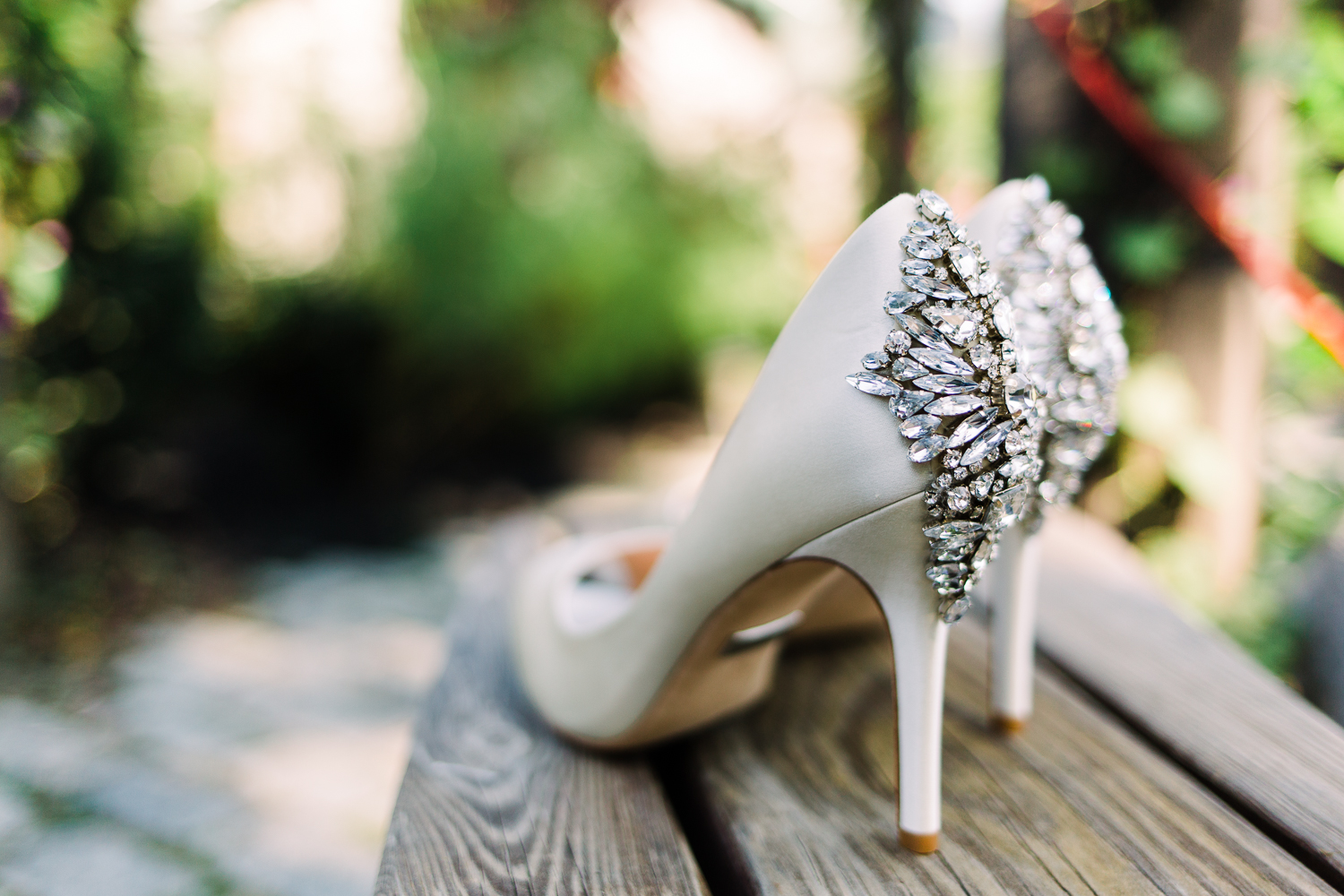 White wedding heels with diamonds on the heels.