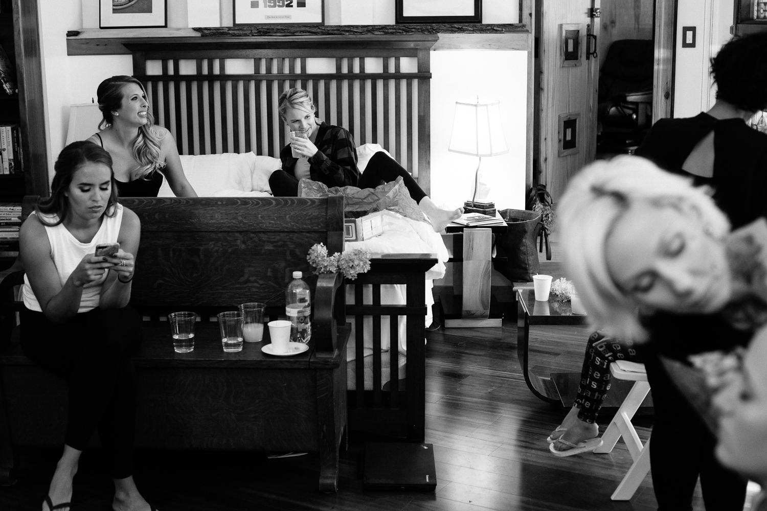 black and white photo of bridesmaids getting ready.