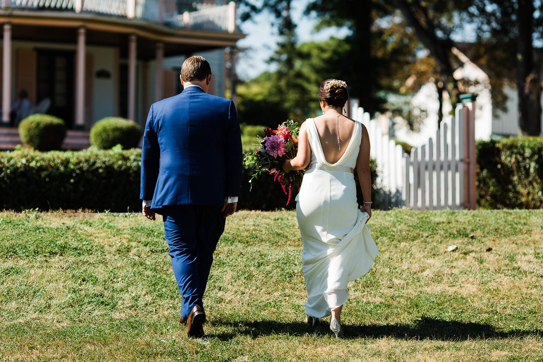 Bride and groom walking away.
