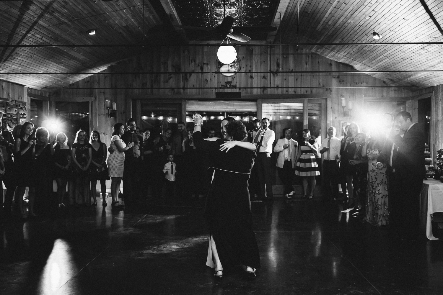 Black and white image of bride dancing with her mother at New Park Retreat in Ithaca, NY.