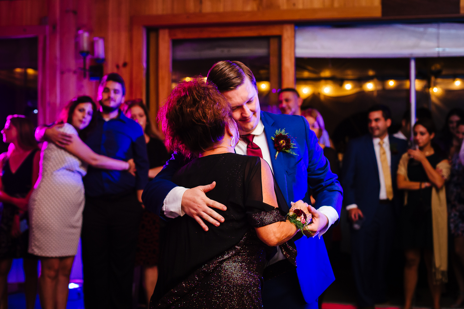 Groom and mother dance at wedding.
