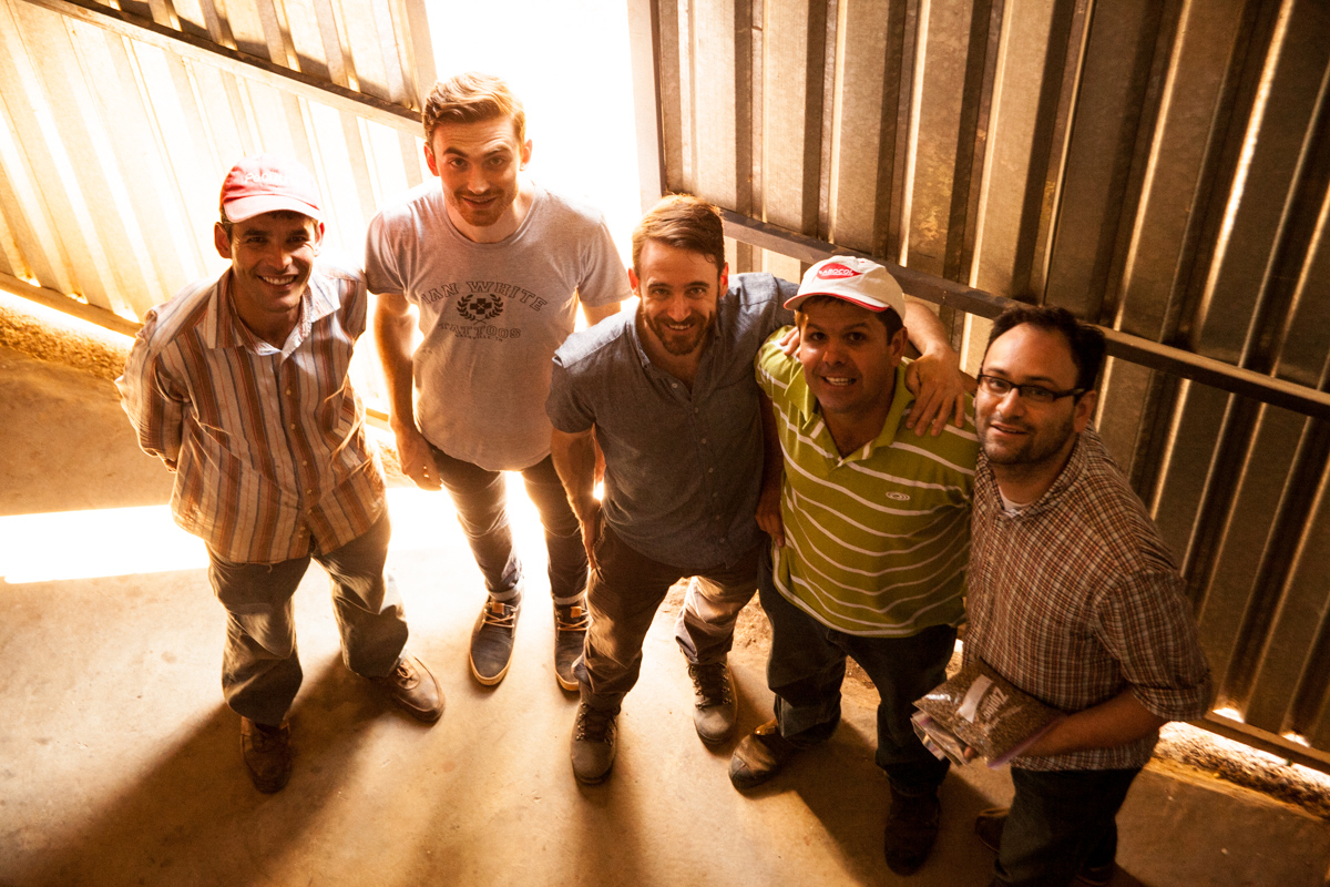 "Saying ""whiskey"" in Luis Alberto's dry storage and mill with brother Oscar. Left to right: Oscar, Sean, Winston, Luis, Aaron (Brown Coffee Co.)"