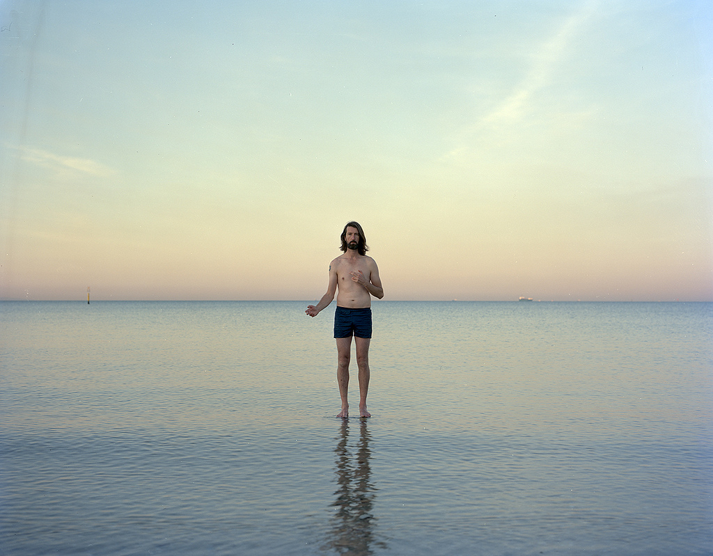 "Ross COULTER,  ""...He walks on water  "",  2013 from the series  Aussie Jesus  chromogenic print 100.0 x 127.0 cm courtesy of the artist     Artist's statement: Drawing on what many consider the first direct self-portrait in the western tradition, the series  Aussie Jesus  refers to Albrecht Dürer's iconic painted self-portrait (1500). The photograph attempts to confront the role of the artist, representations of Jesus and notions of Australian identity."