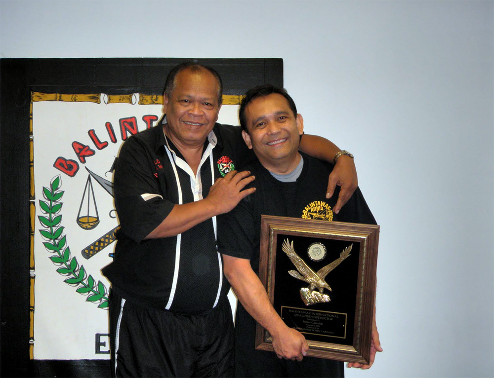 Jemar with Grandmaster Taboada having earned his status as a Fully Qualified Instructor.