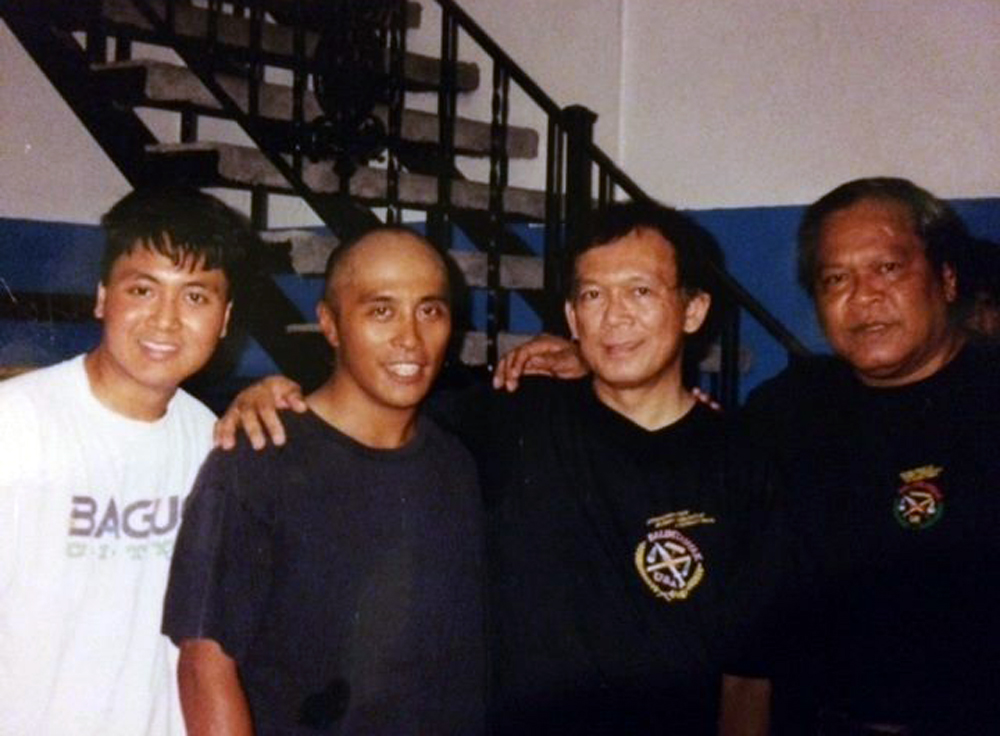 From the Cincinnati Balintawak Club days, Elmann Cabotage (2nd from left) with Grandmaster Jorge Penafil and Grandmaster Bobby Taboada