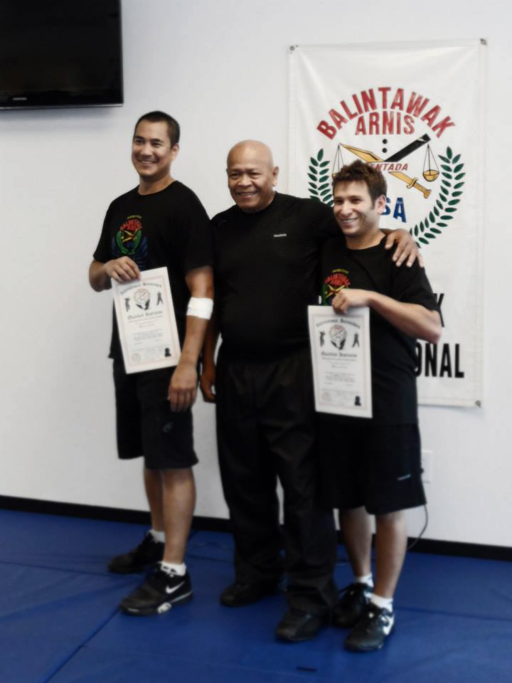 Grandmaster Bobby Taboada presenting Guros Jeff Soraino and Adam Greenspan with their Fully Qualified Instructor certificates.