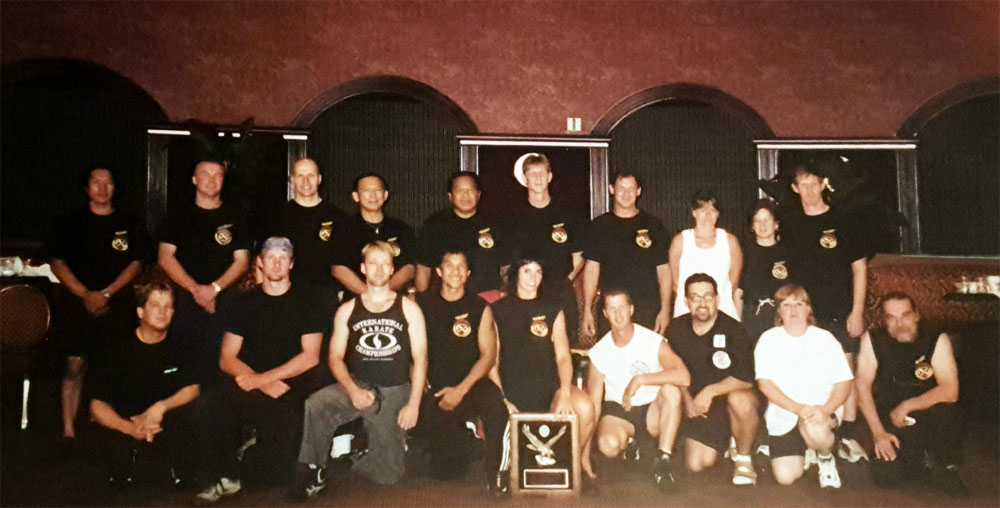 Guro LoParo recieving her FQI status at the Las Vegas Camp in 2000