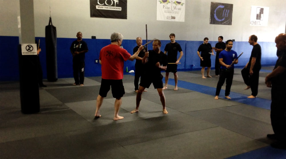 Cam (Center Right) defending and preparing to counter Instructor Terry Chu (Center Left) as GM Taboada looks on (Far Right)