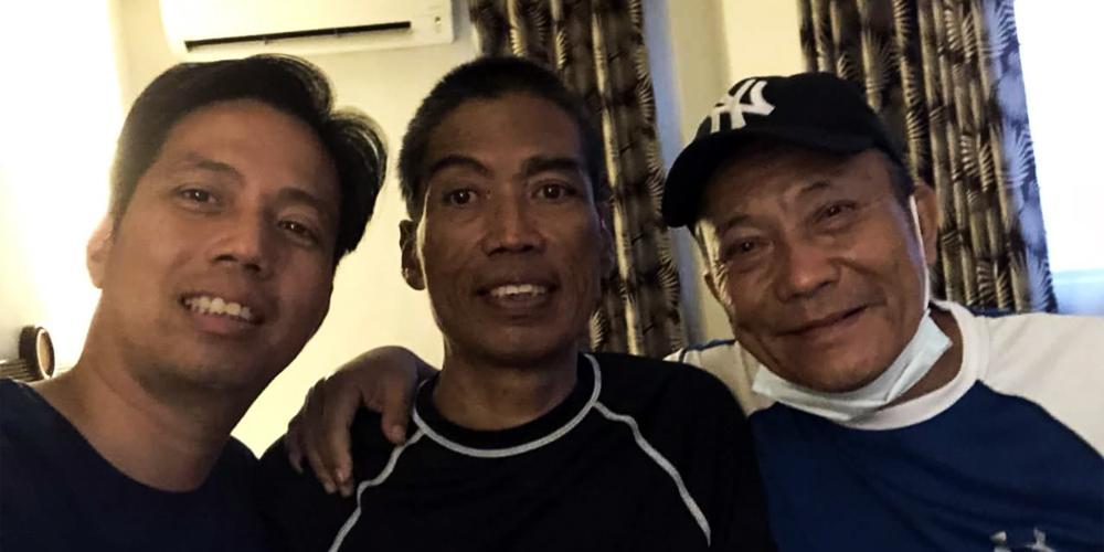 Eugene Nepangue (L), Dr. Ned Racaza Nepangue (C), and GM Monie Velez (R)