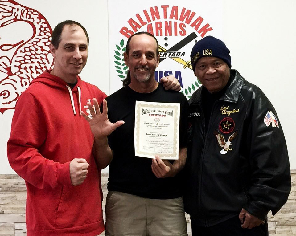 "(from L to R) Guro Brian Corey, Guro Carlos ""Pipo"" Lopez, and GM Taboada at World Camp 2015 where the future Guro Pipo passed his Level 5 examination."