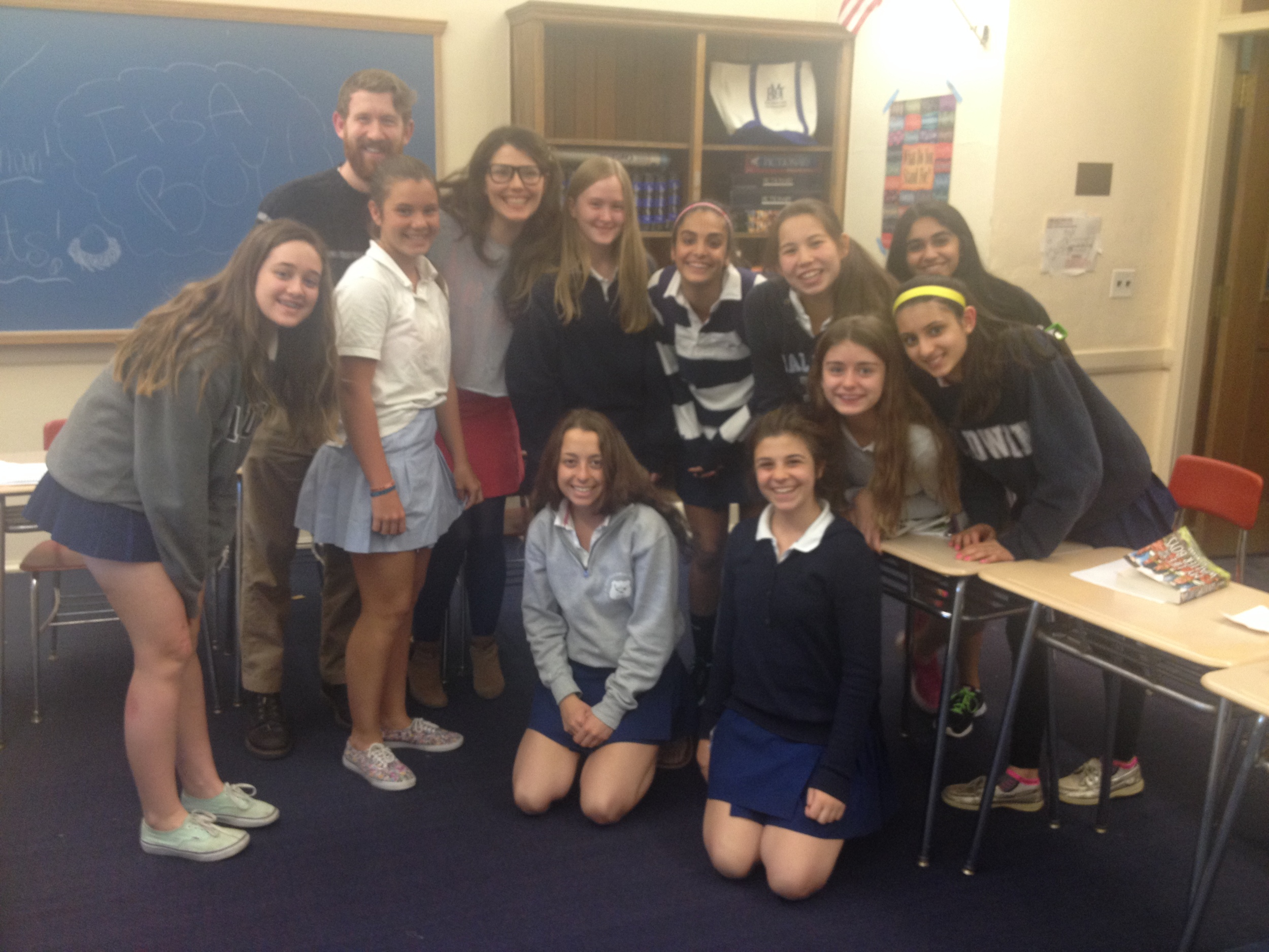 Artistic Director Griffin Stanton-Ameisen and Education Director Jessica DalCanton pose with students at The Baldwin School, following a successful Shakespeare workshop.