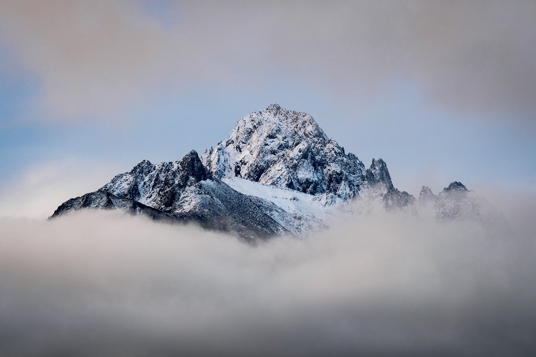 The peak of Mount Sneffels, shrouded in clouds. Near Ridgway, Colorado.