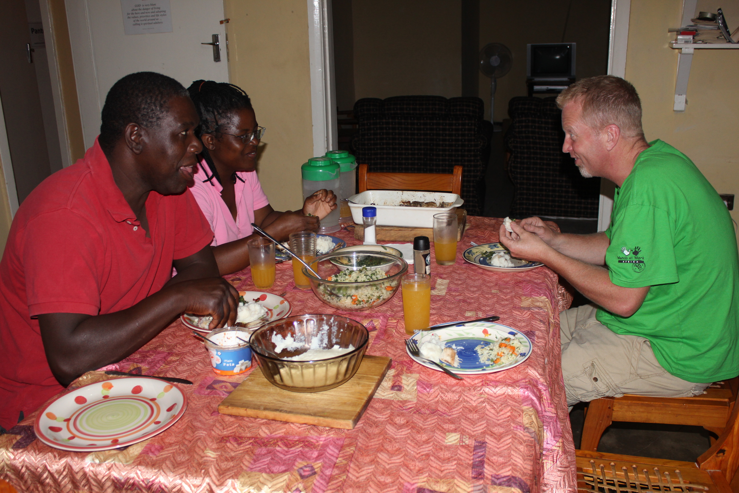 Weston and Liz and Dean at dinner...eating nshima was a new experience for Dean....one of many.