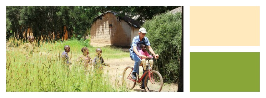 George Snyman gives children bicycle rides during a recent visit to the Zimba Community in northern Zambia.